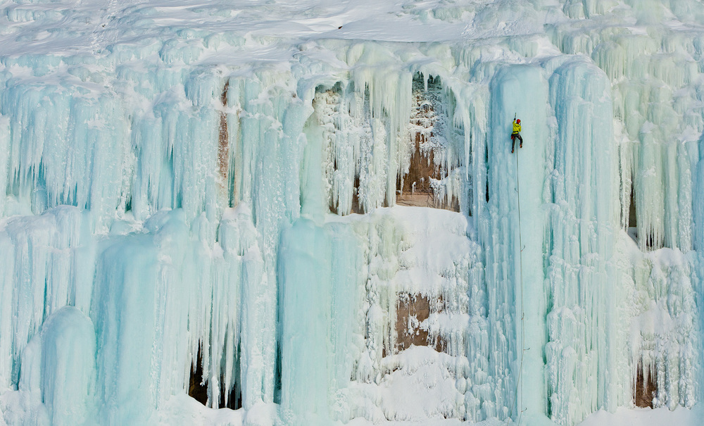 Adam Dailey leading up one of many vertical blue pillars along the west shore of Grand Island.