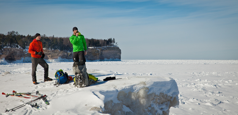 Adam Dailey and Jon Jugenheimer take a rest at Chapel Beach after skiing several miles through the woods.