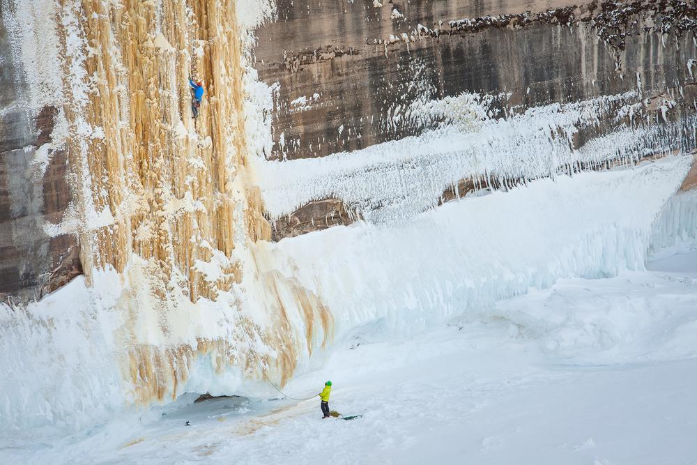 """Jon Jugenheimer belays Adam Dailey from shelf ice below the climb """"HMR."""""""