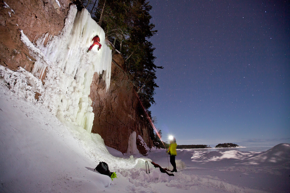 Brandon Snyder works through the short, but brittle ice along Hidden Beach in Marquette during a clear night.