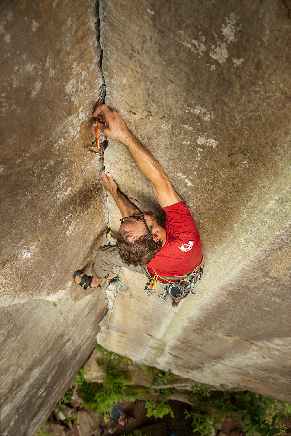 "Adam Brusven looking to get a placement before reaching the anchors of ""Tradisfaction"" in the Red River Gorge."