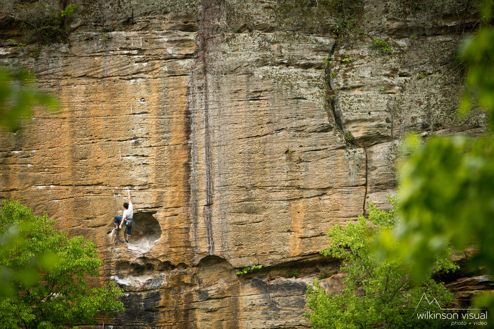 "An unknown rock climber ascends the route ""Banshee"" in the Red River Gorge."