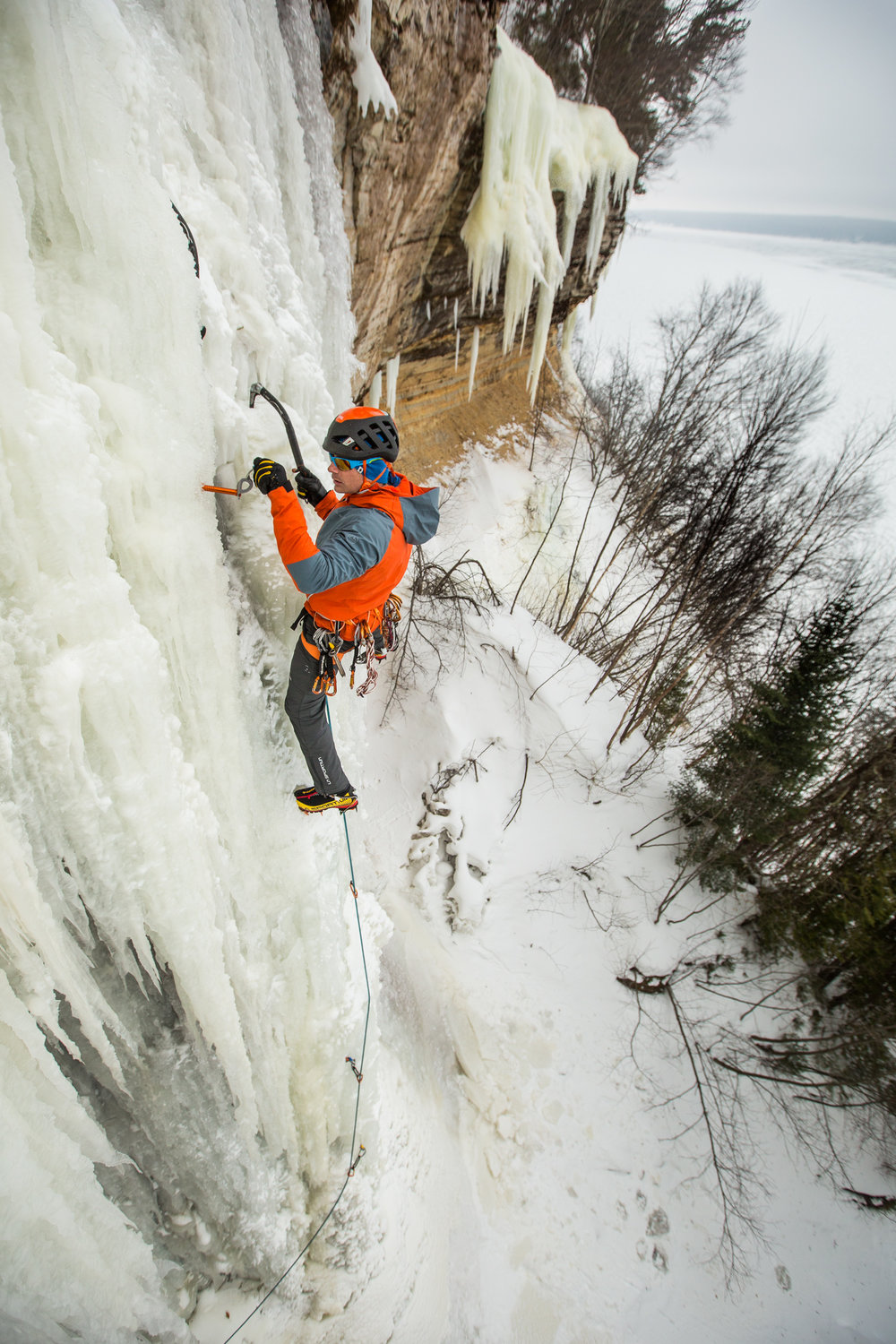 "Karsten Delap climbs ""El Lanzon"" along the Pictured Rocks National Lakeshore in Munising, Michigan."