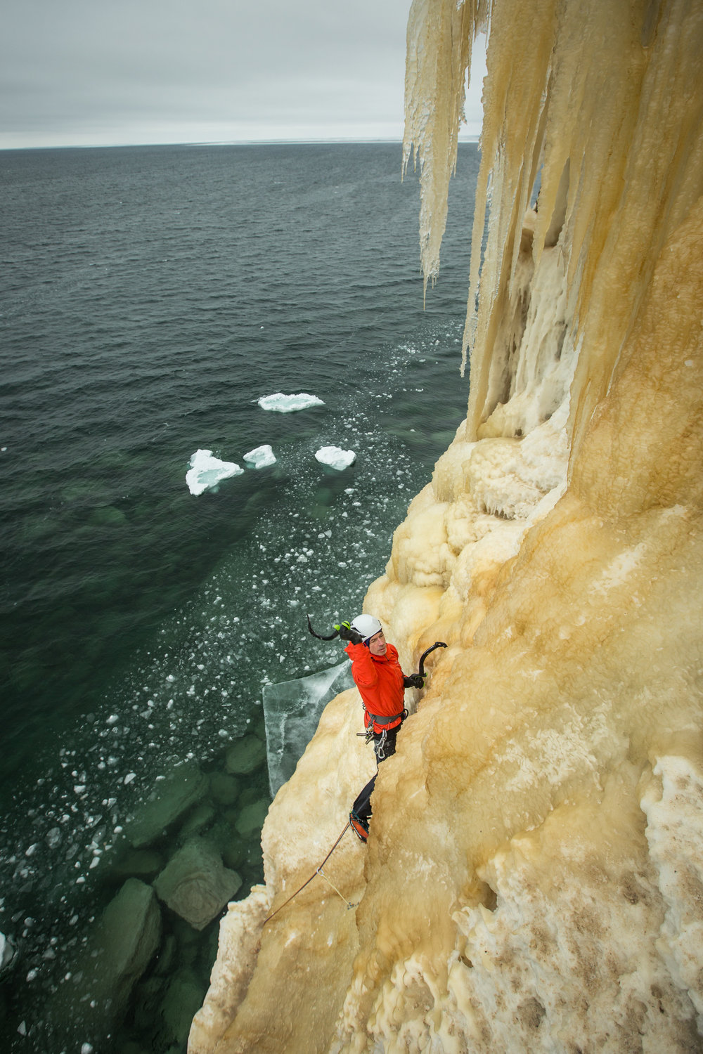"Raphael Slawinski climbs ""Twin Towers"" along the Pictured Rocks National Lakeshore in Munising, Michigan."