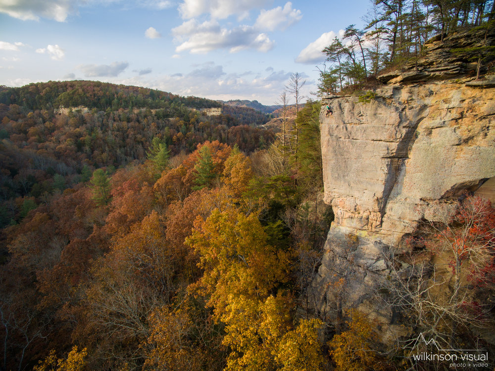 "A climber on ""No Place Like Home"" during a fall sunset in Kentucky's Red River Gorge."