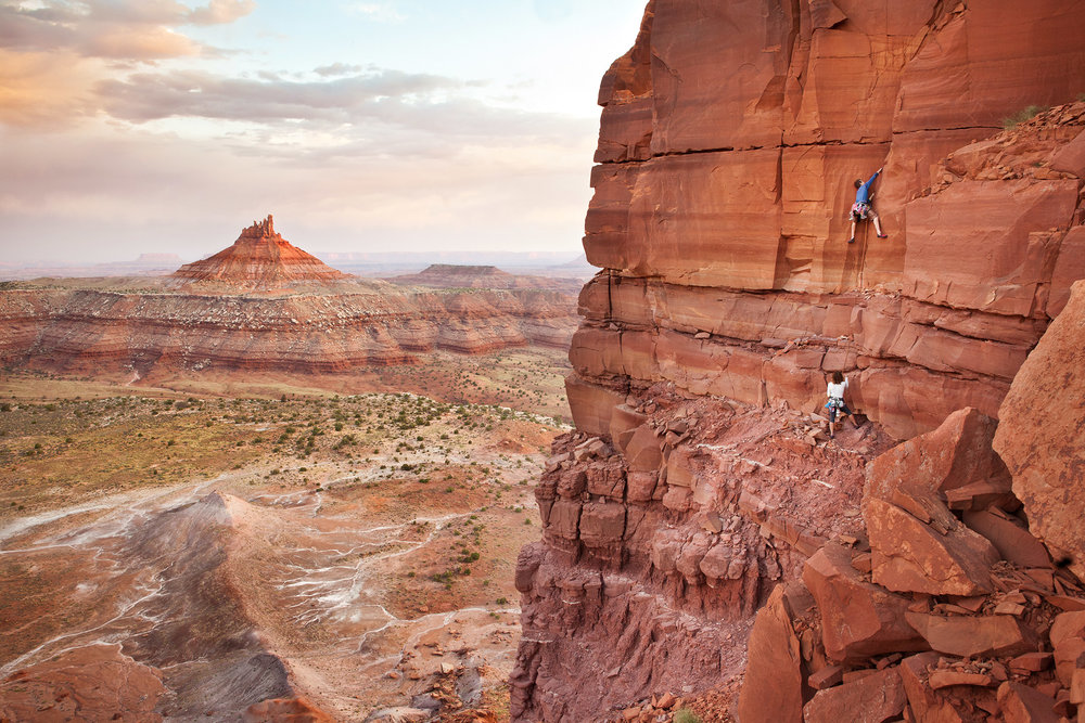 Rock climbers begin their ascent of the first pitch on the South Sixshooter at Indian Creek in Utah.