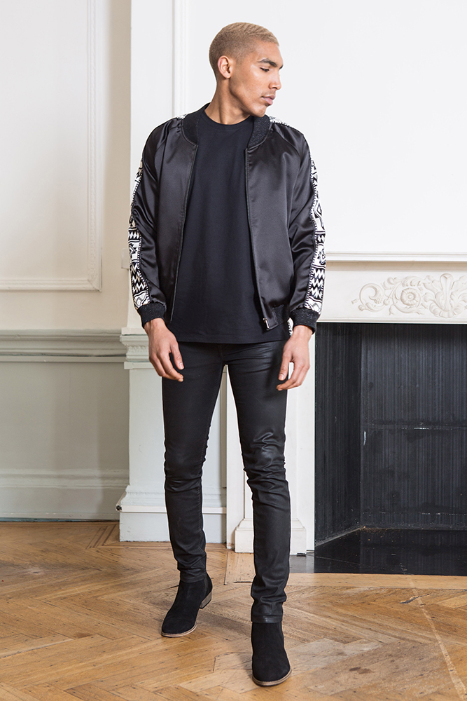 Black sadu print paneled satin jacket
