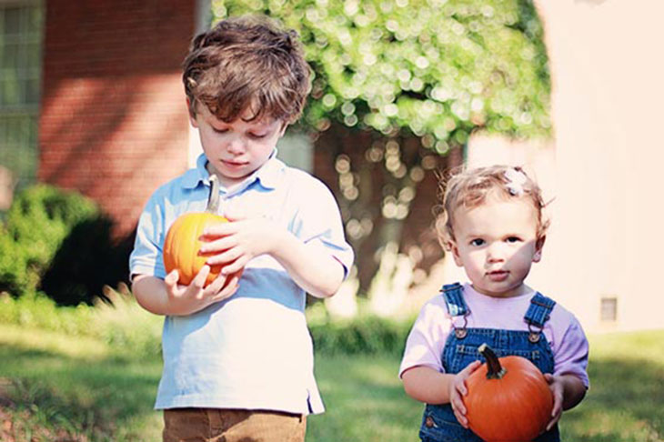 laura and benny with fall pumpkins