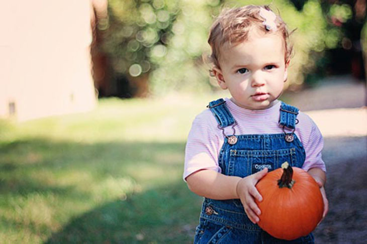 laura with her first fall pumpkin