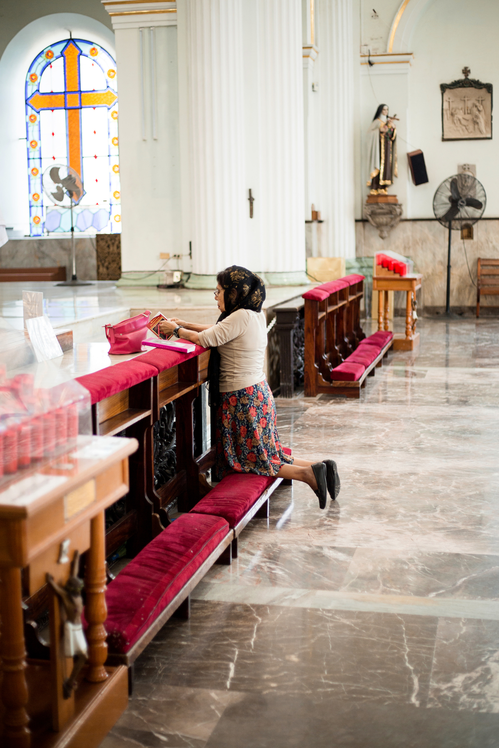 Woman Praying in a Mexican Cathedral