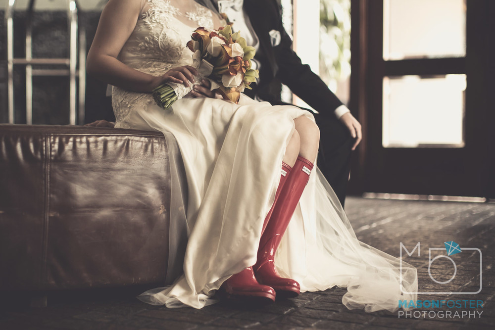 LOVED the red rain boots on her wedding day.