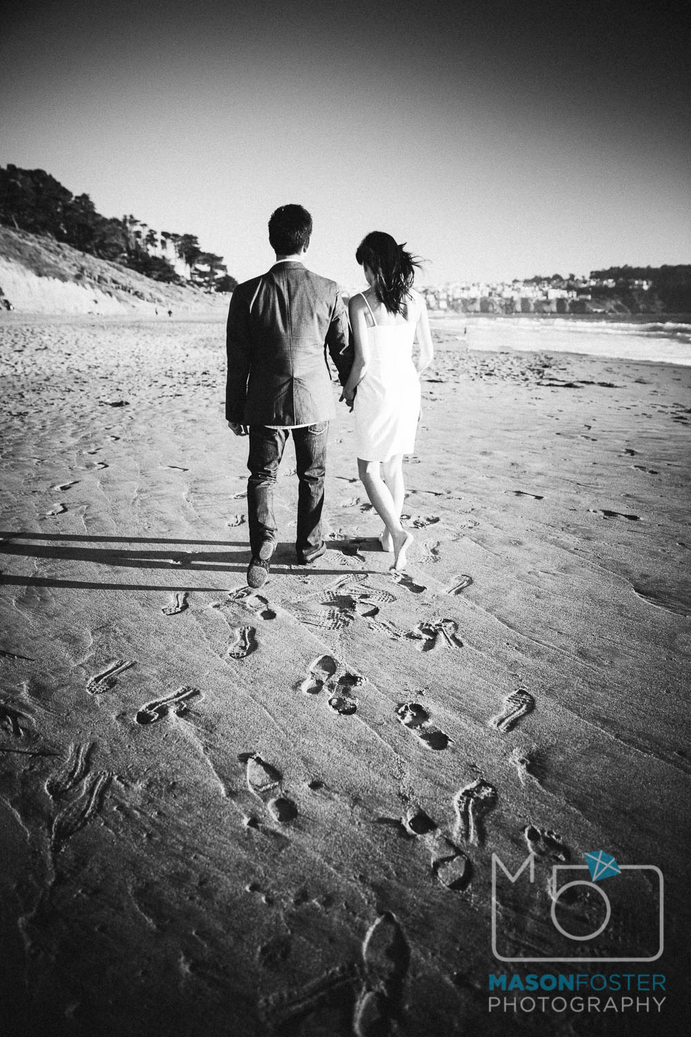 walking along the beach at sunset, baker beach, san francisco - engagement photography