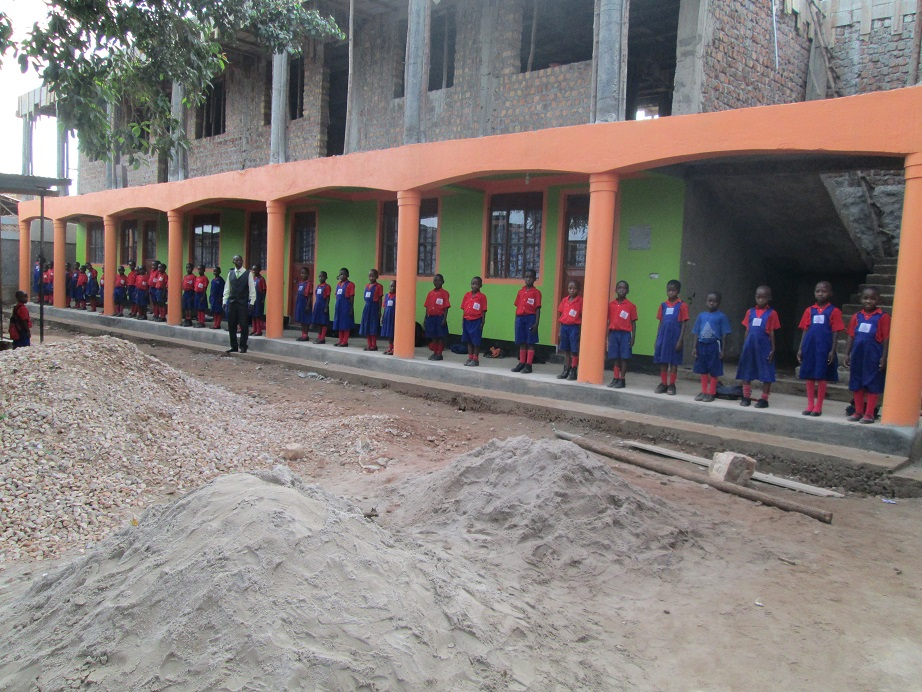 Trinity students stand outside the new dormitory/classroom complex under construction in the fall of 2013.
