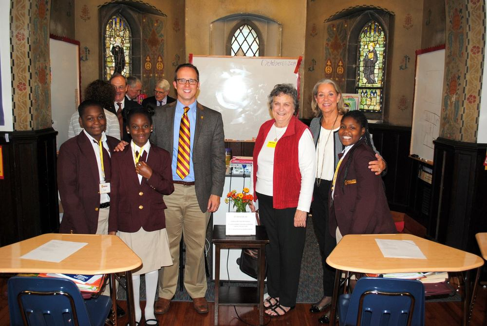 Grateful fifth graders and Head of School David Kasievich ;join ECHOES co-founders Nereida Gordon and Mel Bonder at the dedication of St. James' newest classroom.