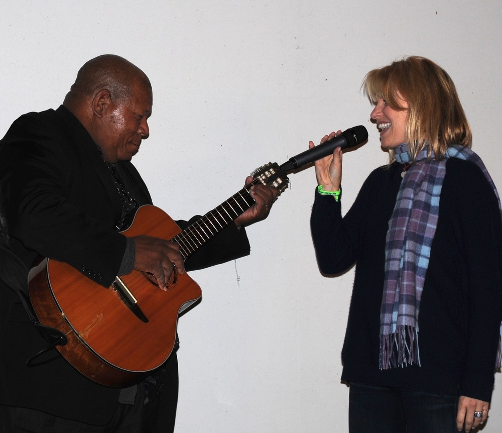Flyers songstress Lauren Hart, an ECHOES Advisory Board member, joins Haitian guitarist Moe Cadet on stage.