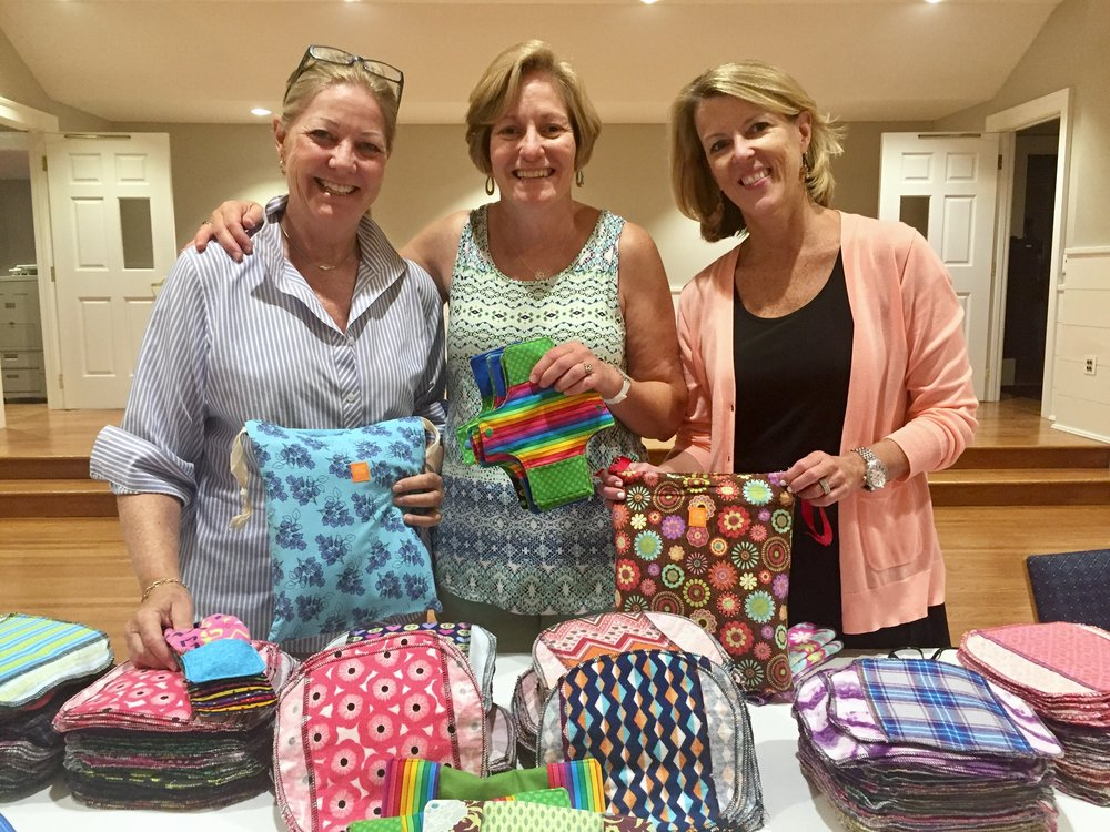 Cissy Claypool, Leslie Roy and Kim Marren and a slew of volunteers created 515 sustainable menstrual kits for girls in Uganda.