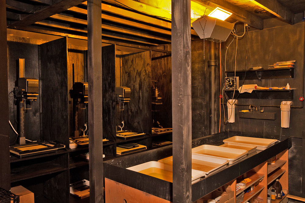 Our gang B&W darkroom is laid out with a large sink in the middle to maximize accessibility.