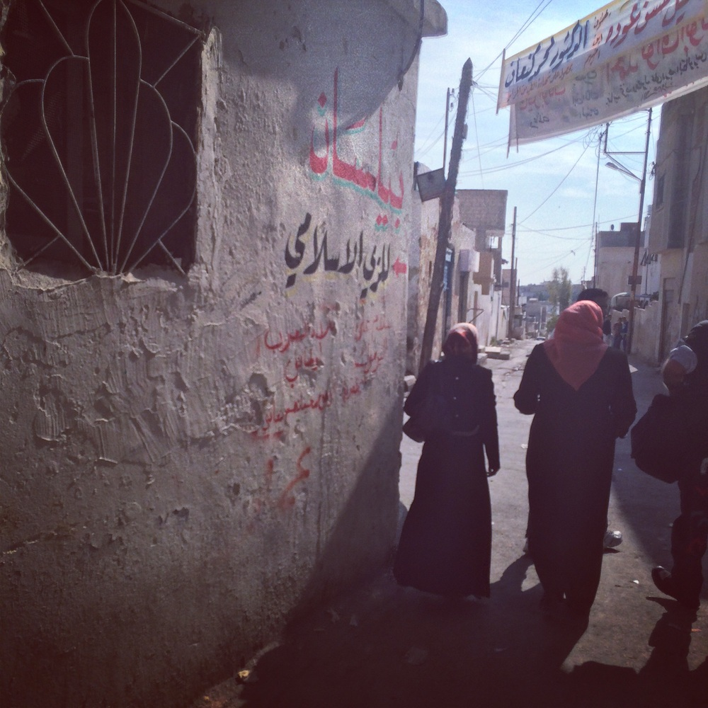 Following women leaders through Madaba Palestinian Refugee Camp in  Madaba, Jordan.