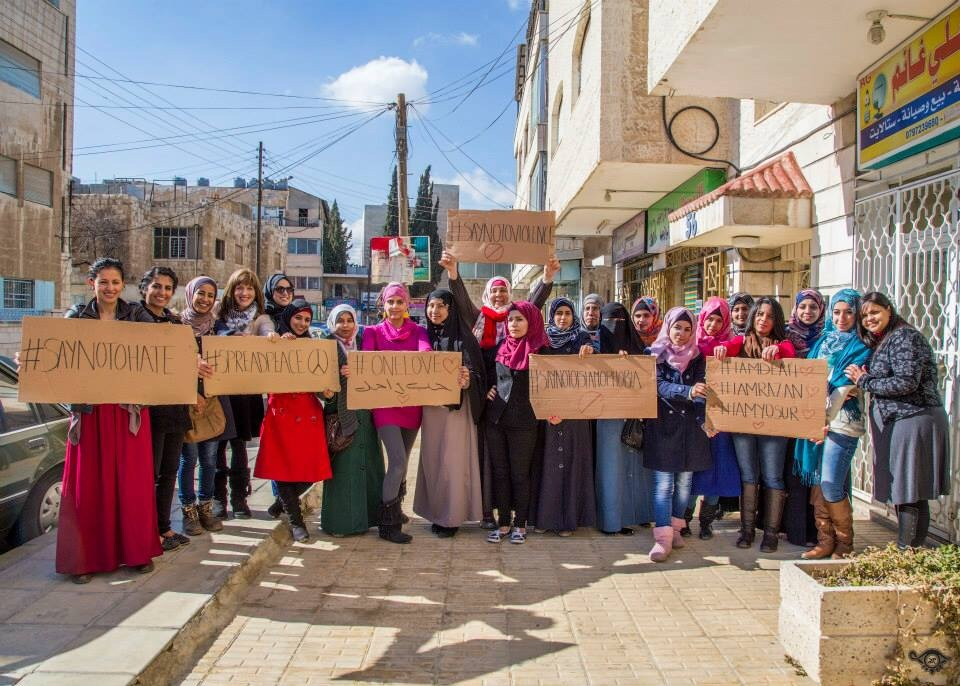 Hopes Scholarship Students, Volunteers, Graduates & Guests joining in one group shot - holding out signs in solidarity with Deah, Razan and Yosur, showing our stance against Hate, Violence and Islamophobia, and our passion for Peace and One Love on this Valentine's Day.
