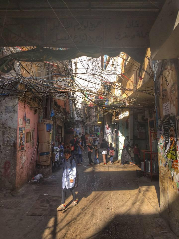 Sun streams through the tangled wires to greet schoolchildren in Chatila Palestinian Refugee Camp, Beirut, Lebanon. November 21, 2016.