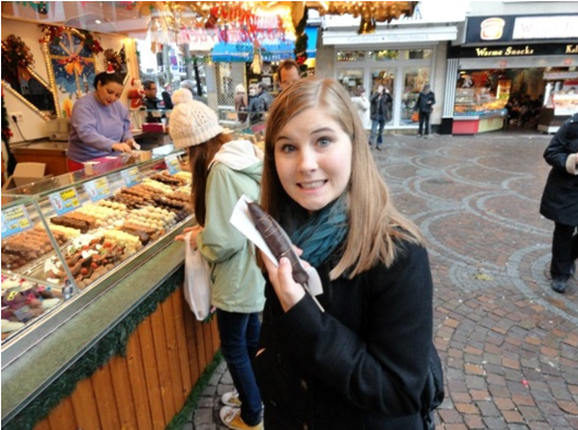 Emily being perverted in Germany. I'm buying grub behind her.