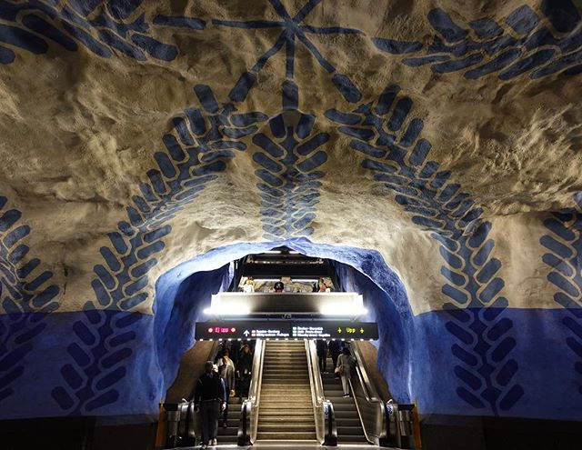 The Stockholm subway system is said to be the world's longest art exhibit at 110 kilometers long. Since the 1950s, over 90 of the 100 subway stations in Stockholm have been decorated with sculptures, mosaics, paintings, installations, engravings, and reliefs by over 150 artists. . T-Centralen, the central station of Stockholm's subway, was the first station to feature artwork. Located a few levels down, the blue line-platform of is one of the most recognizable places with its blue paintings of vines, flowers and silhouettes of workers in swaths of blue and white, painted by the artist Per Olof Ultvedt. . . #T-Centralen #StockholmSubwayArt #subwayart #Stockholm #Sweden #findyouradventure #travelfueledbycuriosity #travel