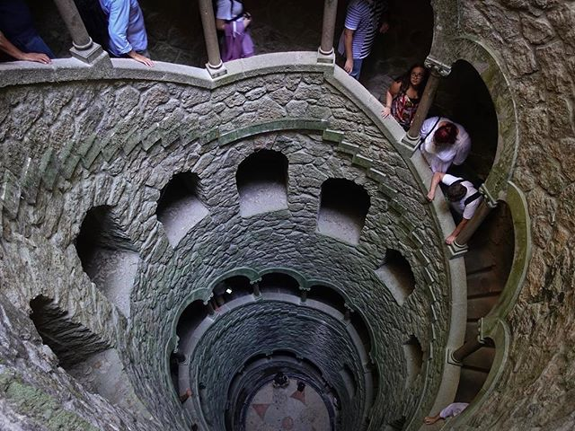 Quinta da Regaleira is a UNESCO World Heritage Site inside Sintra, Portugal. The estate was owned by a wealthy Portuguese businessman Antonio Augusto Carvalho Monteiro, who was also a well-known Freemason. He ordered construction the four-hectare property with enigmatic buildings, mysterious parks, and secret underground tunnels. . All of the structures erected in Quinta da Regaleira are filled with many symbols, which are linked to masonry, alchemy, the Rosicrucian and Hermetic legacy, the Knights Templar and Tarot mysticism. . One of the more intriguing sites are the Initiation Well. It was never used to carry water, but was actually built for secret ceremonial purposes. The Initiation Well has a spiral staircase descending 88 feet to the bottom of the well through its nine landings. It is believed that the spacing of these landings, as well as the number of steps in between, are linked to Tarot mysticism and Masonic principles. At the bottom of the Initiation Well is a compass over a Knights Templar cross, which is said to have been the coat of arms of Carvalho Monteiro, pointing to his association with Rosicrucianism. . The nine small round landings, separated by fifteen steps, also evoke references to Dante's Divine Comedy and may represent the 'Nine Circles of Hell', the 'Nine Sections of Purgatory' and the 'Nine Skies of Paradise'. . . #Sintra #QuintaDaRegaleira #Portugal #InitiationWell #spiralstaircases #findyouradventure #travelfueledbycuriosity #travel