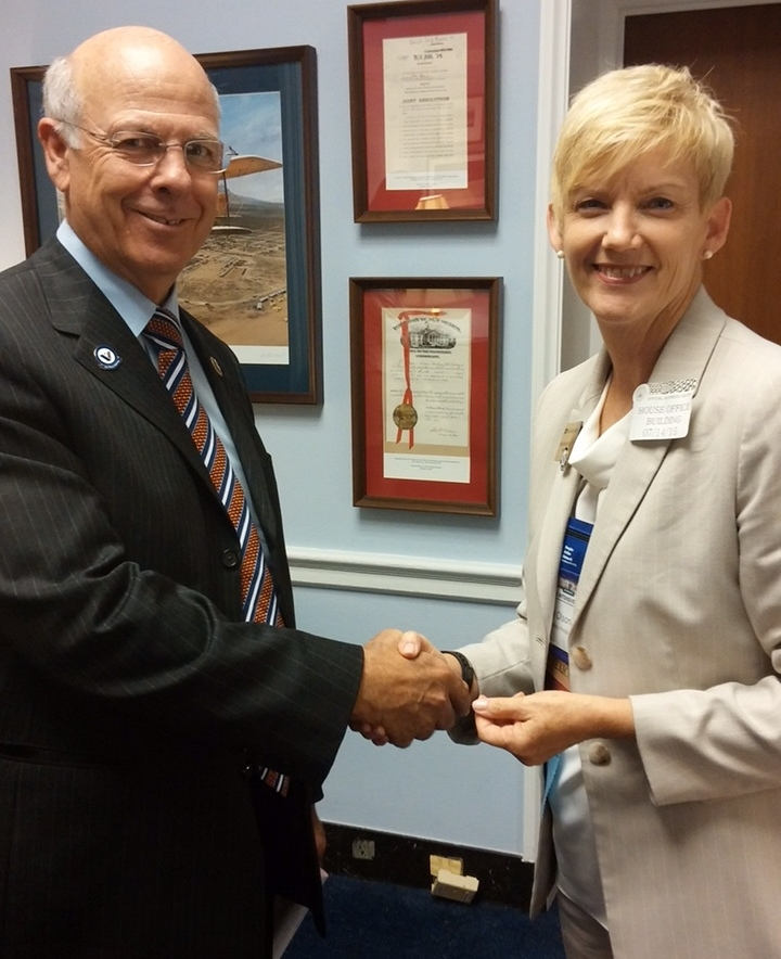 HAN 2015 Congressman Pierce Kathy Olson After WHV Pinning.jpg