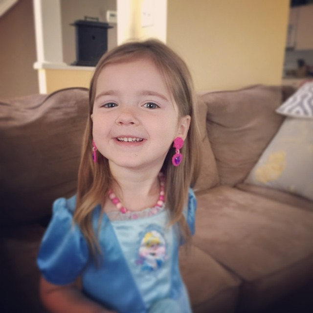 Lili's first pair of clip on earrings. She's in love!