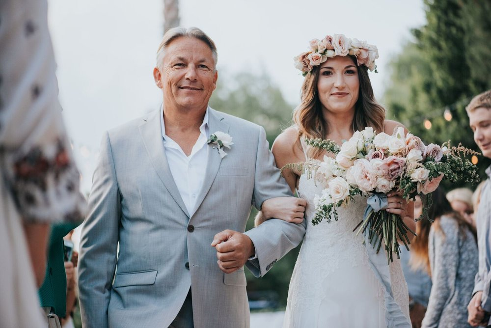 Katie being escorted down the aisle by her dad.