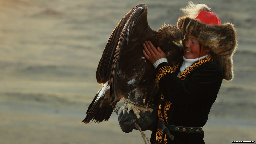 Ashol-Pan, Mongolia's only female eagle huntress.  Photograph by Asher Svidensky
