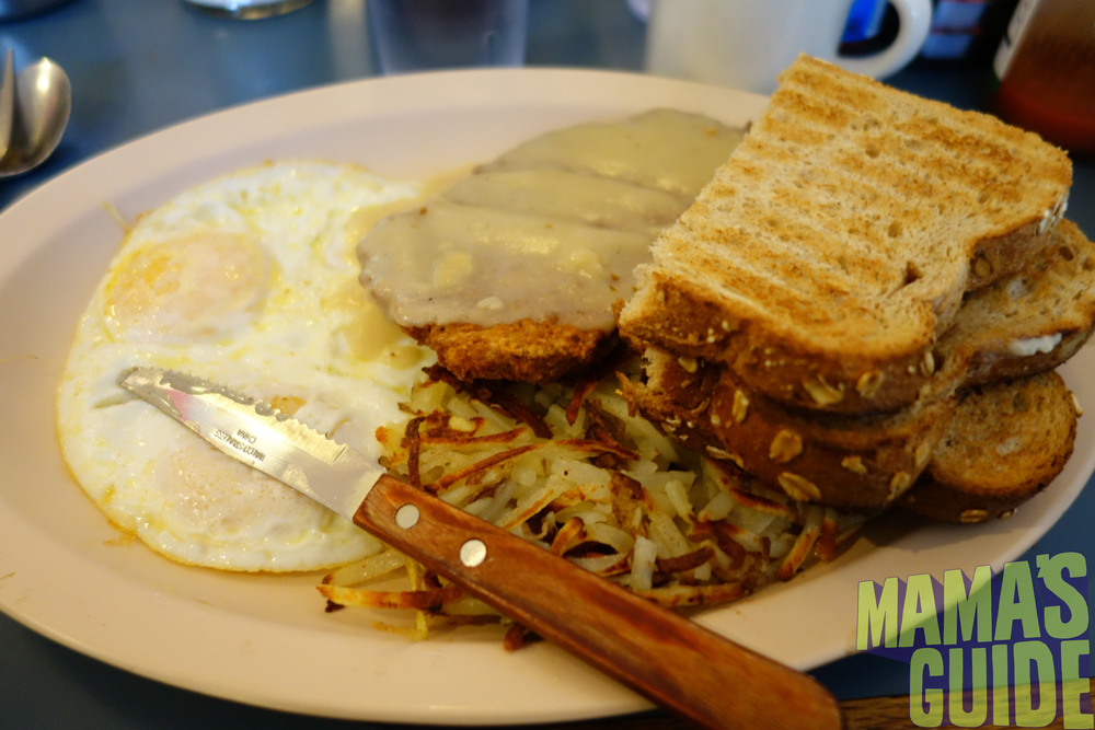 Chicken fried steak with gravy, eggs over easy and those awesome hash browns!