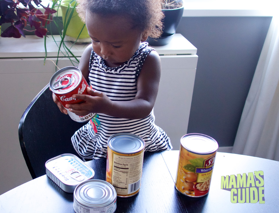 My assistant checking the dates on our canned goods.