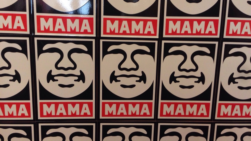 These mama stickers are all over the bathroom door. Very welcoming :)