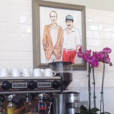 A painting of the previous owners at the newly reopened Breakfast At Tiffany's. Photo courtesy Jennifer A. via Yelp.