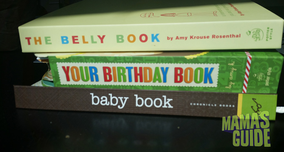 My baby book stash. The Belly Book was awesome while pregnant (because I wasn't distracted by a baby yet). The Birthday Book is also a good one because it literally needs to be touched once a year. But that last baby book? SO cute, and almost empty :(