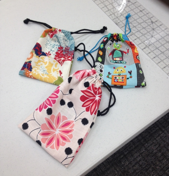 Drawstring bags completed in a Sew Giving lesson