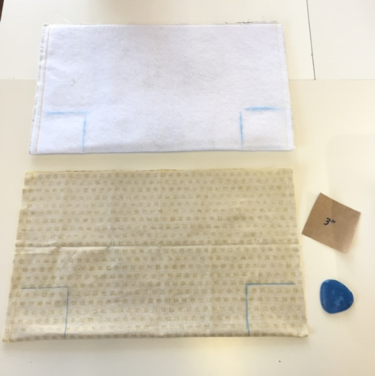 "2. Using a 3"" square of paper as a guide and tailor's chalk (or pencil), draw a square on each bottom* corner of the exterior fabric (front and back sides). Repeat with the lining fabric. Note: Align the paper guide along the seam. The *bottom is the folded edge."