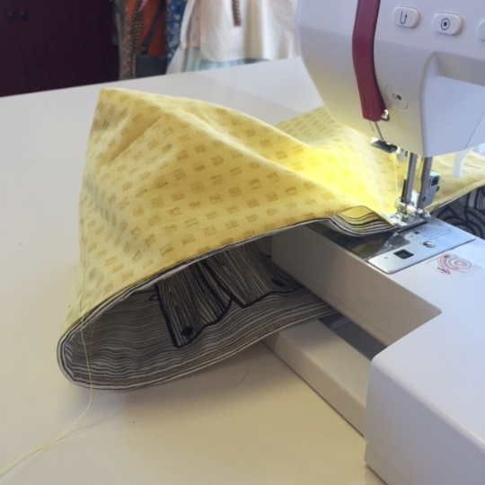 6. Once the basket is turned right-side-out, press the top edge with an iron and then topstitch.  A topstitch seam will help to define the top edge and also will close the 4 inch opening.