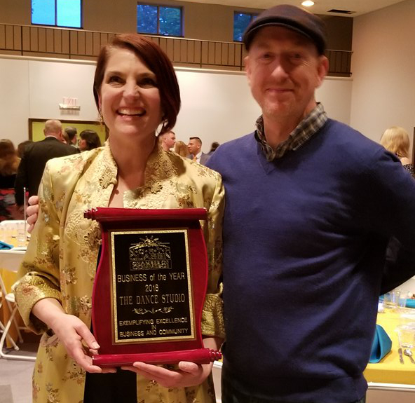Ingrid Schatz and Bryan Long with her Award from the North Quabbin Chamber of Commerce for Business of the Year 2018.
