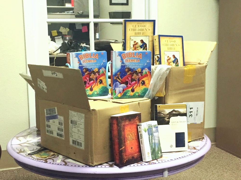 One of the three cases of Bibles that were donated by RAI Group of Texas