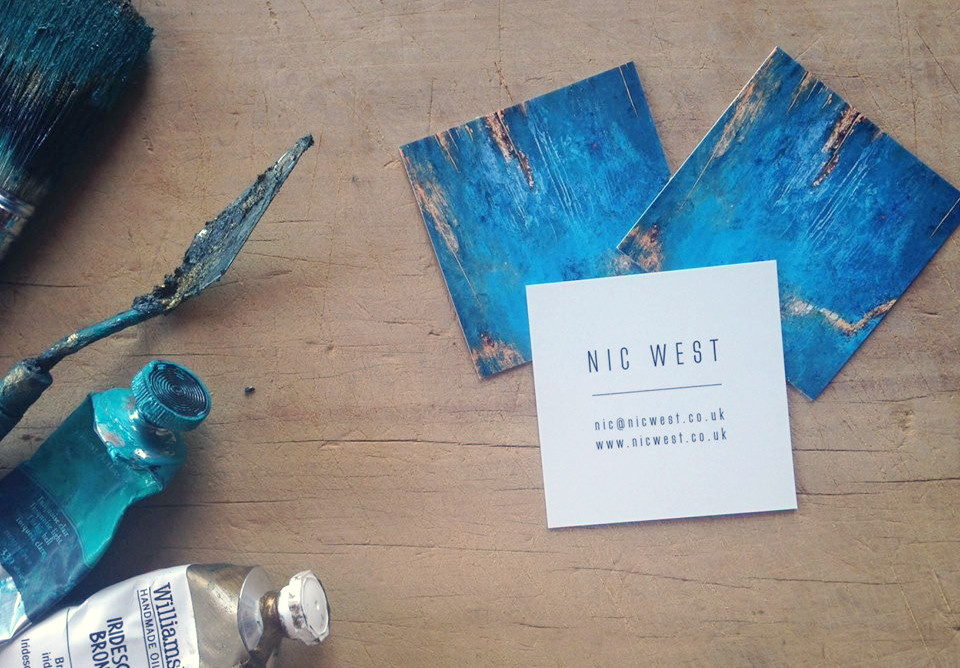 Business cards with little tasters of artwork