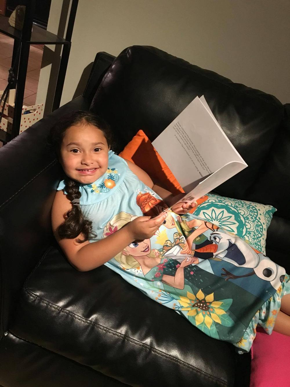 girl in tinkerbell nightgown reading dinosaur hiccups