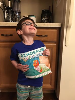 AJ loves his dinosaur hiccups book!
