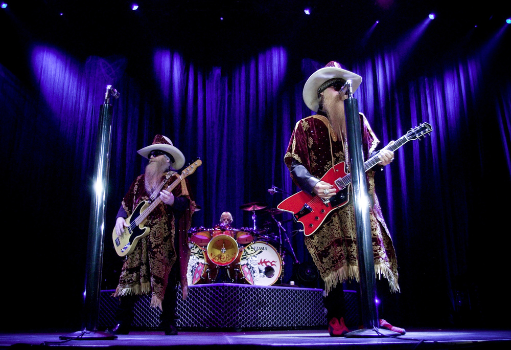 Dusty Hill, Frank Bears, and Billy Gibbons performing live