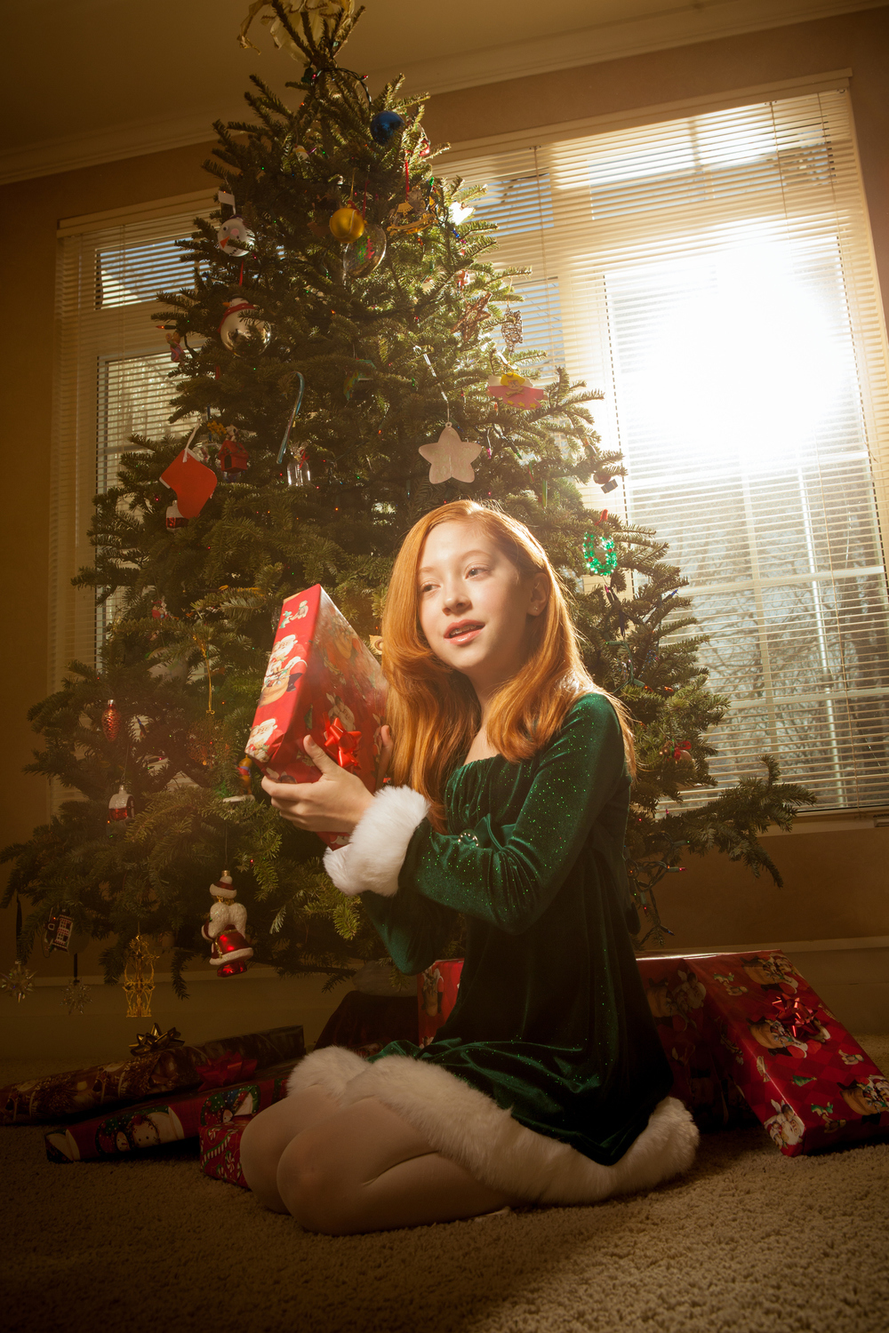 Christmas day portrait, child opening present