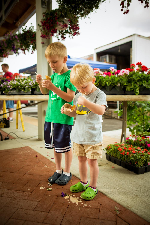 portrait of two children eating ice cream