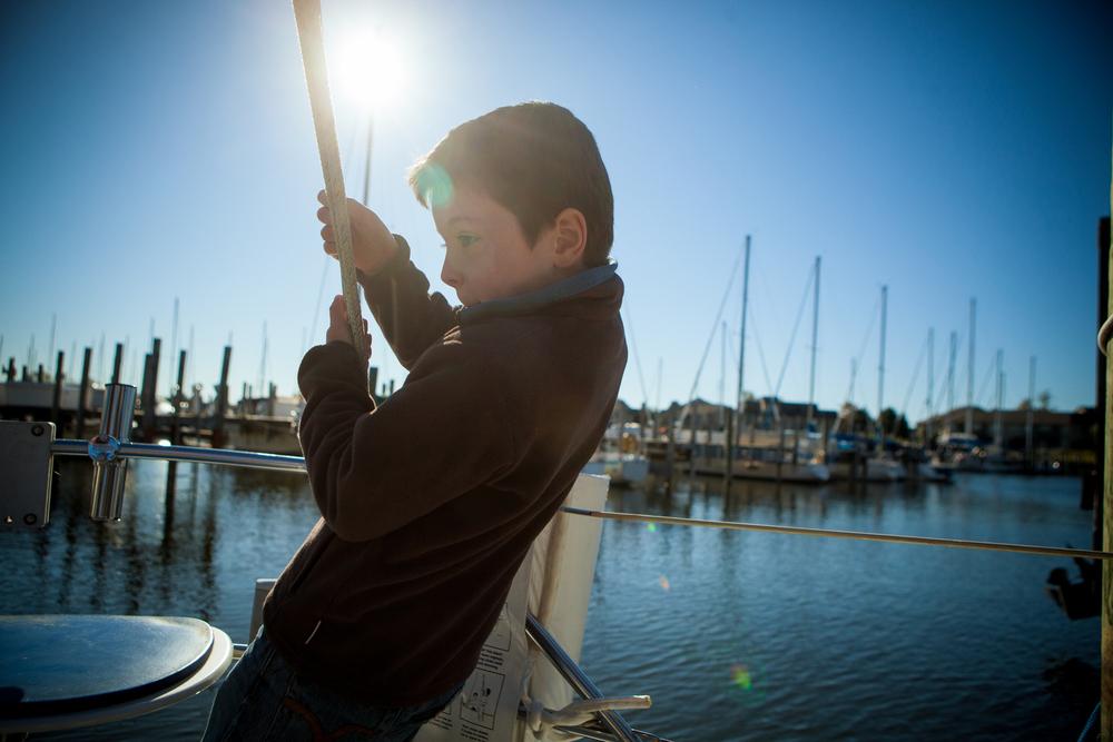 child's portrait on the dock at Lake Michigan