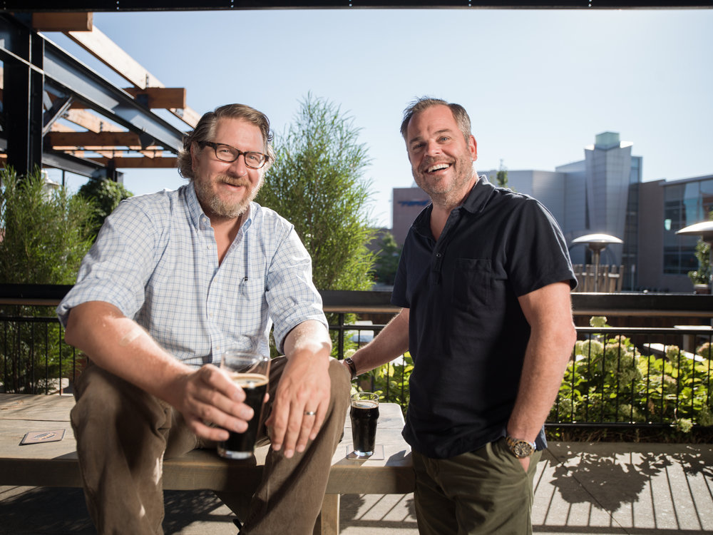 Dave Engbers, left, and Mike Stevens started Founders Brewing Co., which makes them the envy of beer lovers everywhere.