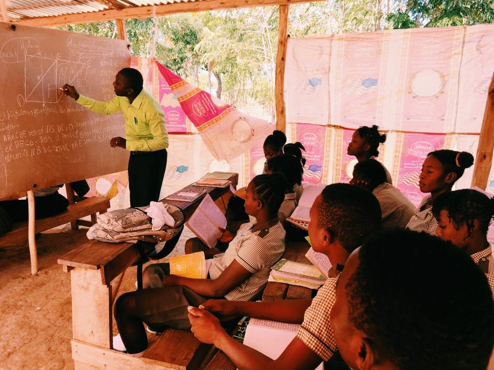 APOLUS DAMEUS TEACHES in the Terre-Salei School where Ysemane's children attend.
